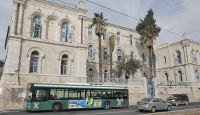 A bus owned by Egged, Israel's largest bus company, passes old buildings in Jerusalem on Dec. 3, 2014. (photo by AFP/Getty Images/Ahmad Gharabli)