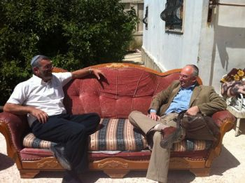 Knesset members Michael Ben-Ari (left) and Aryeh Eldad on the evicted Natcheh family's sofa in Beit Hanina. (Photo: Michael Ben-Ari)