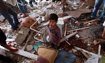 Palestinians inspect a damaged classroom of the UN school in Jabalia, northern Gaza. Photograph: Mohammed Saber /EPA